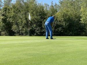 Spieler am Golfplatz